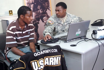 Army Staff Sgt. Roger L. Whaley speaks with Phillip McDonald about the possibility of becoming a journalist or X-ray technician for the Army at the U.S. Army Recruiting Station in Radcliff, Kentucky. Army photo by Sgt. Carl N. Hudson