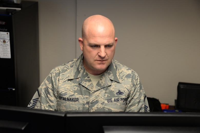 Master Sgt. James Stalnaker, 60th Maintenance Squadron, works at his desk at Travis Air Force Base, Calif., March 20, 2017. Stalnaker suffered a traumatic brain injury, broken ribs and several other injuries in a motorcycle crash in October 2015. He is now a master resiliency training instructor and shares his personal resilience story with Travis Airmen. (U.S. Air Force photo/Tech. Sgt. James Hodgman/Released)