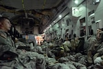 Paratroopers ride in a C-17 aircraft from Alaska to their jump site in Australia, a 17-hour flight that left many trying to get some pre-jump rest on the aircraft. The quality of soldiers' sleep has a direct bearing on readiness, an Army researcher said. Army photo by David Vergun