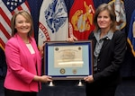 DLA Energy Acting Deputy Commander Gabby Earhart presents Acting Assistant Secretary of Defense for Logistics and Materiel Readiness Kristin French with a certificate of appreciation for her participation in the DLA Energy Women's History Month program, March 21. Photo by Ron Inman