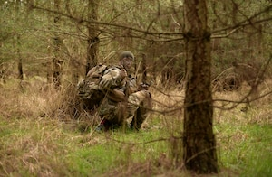 A U.S Air Force Air Commando from the 352nd Special Operations Wing gives a thumbs up during a field training exercise, March 8, 2016, at the Stanford Training Area, England. Airmen were instructed on how to properly survive, evade, resist and escape if taken by captors. (U.S. Air Force photo by Senior Airman Christine Halan)