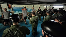 U.S. Air Force instructors and students gather for an initial briefing before conducting training March 10, 2017, at Lowestoft College, Maritime and Offshore Facilities, England. Airmen from the 100th Air Refueling Wing, and 352nd Special Operations Wing from RAF Mildnehall, England, and 48th Fighter Wing from RAF Lakenheath, England, receive refresher training every three years, which consists of hand-to-hand combatives, combat survival training and water survival training. (U.S. Air Force photo by Senior Airman Christine Halan)