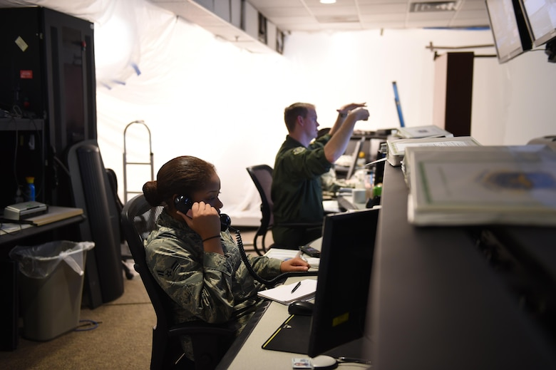 Airman 1st Class Dekenya Jackson, 62 AW Command Post controller, answers a call at the 62nd Airlift Wing command post on Joint Base Lewis-McChord, Wash., March 20, 2017. The command post is the hub for information being relayed on McChord Field, and has recently undergone major renovations. (Air Force photo/ Staff Sgt. Naomi Shipley)