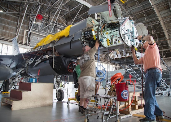 Maintenance personnel install mounting hardware for an APG-83 Scalable Agile Beam Radar on a 416th Flight Test Squadron F-16 Fighting Falcon in August 2015. The 416th FLTS has been conducting developmental testing on the fifth-generation Active Electronically Scanned Array fire control radar. (U.S. Air Force photo by Christopher Okula)