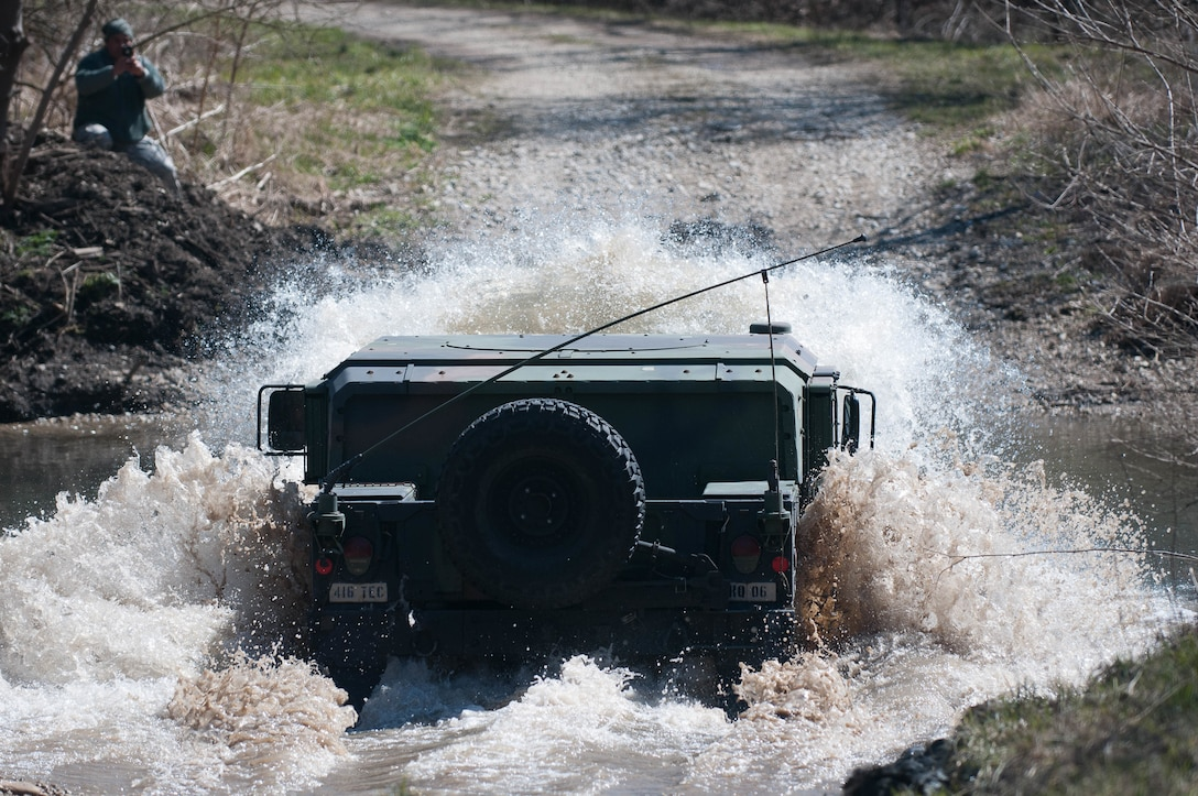 A 416th TEC Soldier fords a water obstacle during a portion of the offroad driving course at the Joliet Training Area, Elwood, Ill. The water fording offers trainees the ability to feel how the M1165 A1 HWMMV navigates all types of water obstacles, in a controlled environment (U.S. Army photo by Staff Sgt. Jason Proseus/released).