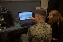 A Marine shows a member from the Defense Advanced Research Projects Agency how he uses a 3-D printer at the additive manufacturing facility at Camp Lejeune, N.C., March 22, 2017. Nine members with the Defense Advanced Research Projects Agency visited the facility to learn more about how technology is benefitting the Marine Corps. The Marines are with 2nd Maintenance Battalion, Combat Logistics Regiment 25, 2nd Marine Logistics Group. (U.S. Marine Corps photo by Pfc. Abrey Liggins)
