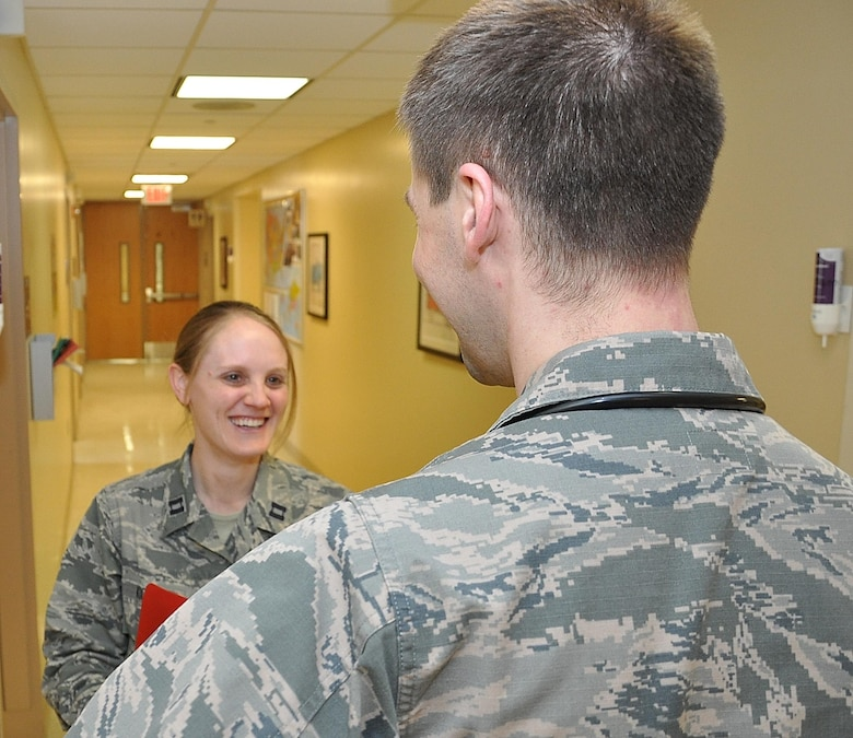 Pediatrician Major (Dr.) Michelle Kiger, 88th Medical Operations Squadron, discusses some of the day's issues with Capt.(Dr.) Eric Engstrom, 88th MDOS Pediatric Resident physician, during her rounds at the Wright-Patterson Air Force Base, Ohio, Medical Center. Kiger and Engstrom, as well as all physicians across America, are being lauded during National Doctors Day observances, March 30. (U.S. Air Force photo by Will Huntington)