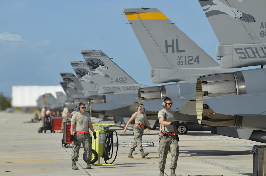 114th Aircraft Maintenance weapon loaders mount a training missile on a F-16C during a training mission March 14, 2017, Naval Air Station Key West, FL. The purpose of the deployment was to train with the U.S. Navy and Canadian Air Force. This training serves as the culmination of the 175th Fighter Squadron air-to-air training. (U.S. Air National Guard photo by Maj. Travis Schuring/Released)