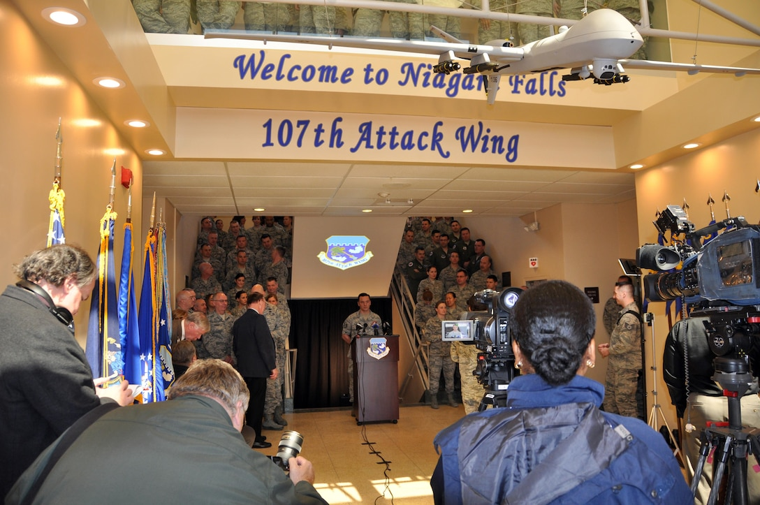 Members of the 107th Attack Wing along with invited guests and local media outlets gather for the official ceremony announcing the redesignation of the 107th from an airlift wing to an attack wing, March 21, 2017 at the Niagara Falls Air Reserve Station N.Y.  The 107 ATKW, NY Air National Guard, is the largest tenant organization on NFARS. The host unit of the base, the 914th Airlift Wing of the Air Force Reserve will be receiving its own redesignation in June as it converts from an airlift wing to an air refueling wing.  (U.S. Air Force photo by Master Sgt. Kevin Nichols)