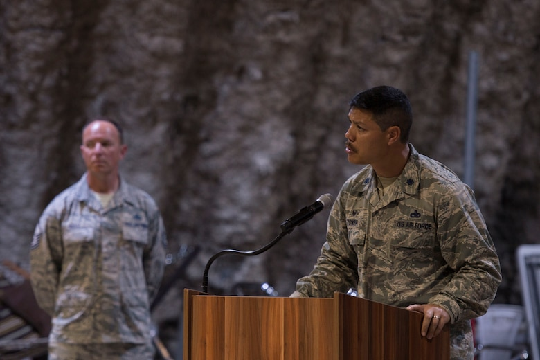 Lt. Col. Paul Tower, 332nd Expeditionary Maintenance Squadron commander, speaks during a fallen warrior memorial ceremony Mar. 23, 2017, in Southwest Asia.Tower spoke about Staff Sgt. Alexandria Morrow, 332nd Expeditionary Maintenance Squadron weapons load crew member, who died from injuries sustained while performing work duties in support of Operation Inherent Resolve. (U.S. Air Force photo by Staff Sgt. Eboni Reams)