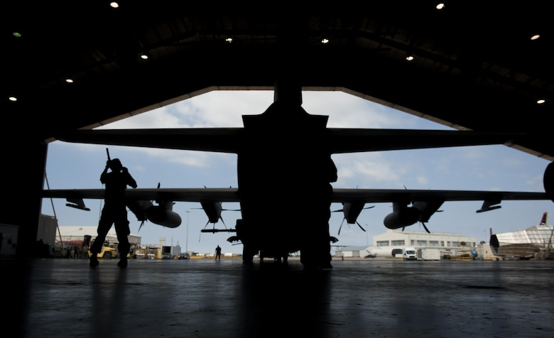 Staff Sgt. Nikolas Kimmel, a crew chief with the 1st Special Operations Aircraft Maintenance Squadron, tail walks an AC-130J Ghostrider gunship at Eglin Air Force Base, Fla., March 20, 2017. Kimmel wing walked the gunship to safely usher the aircraft into the McKinley Climatic Laboratory, a hangar used to test an aircraft's ability to operate under extreme conditions, such as low temperatures and high winds. (U.S. Air Force photo by Airman 1st Class Dennis Spain)