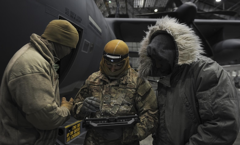 Air Commandos from the 1st Special Operations Aircraft Maintenance Squadron look at a step-by-step checklist at Eglin Air Force Base, Fla., March 21, 2017. This checklist was used to bring power to the AC-130J Ghostrider gunship while it underwent its first cold soak, a test done to examine the aircrafts operational competence and resilience in arctic temperatures. (U.S. Air Force photo by Airman 1st Class Dennis Spain)