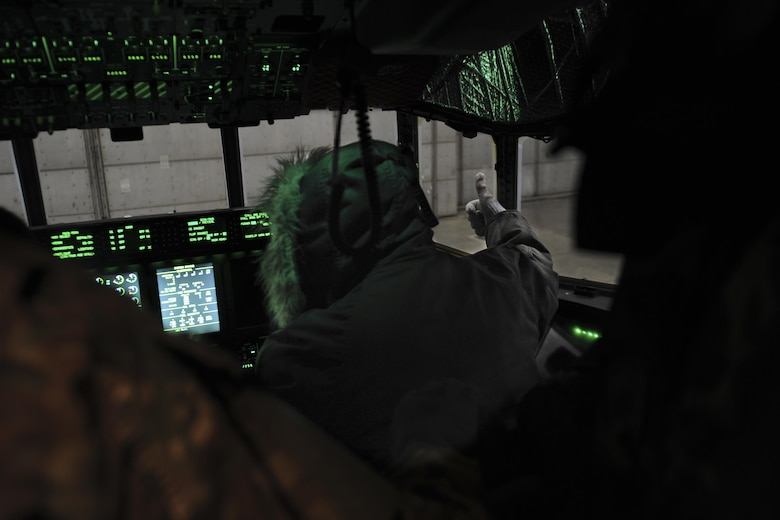 Christopher Williams, an electrician with the 1st Special Operations Aircraft Maintenance Squadron, gives a team mate a thumbs up at Eglin Air Force Base, March 21, 2017. The AC-130J Ghostrider gunship underwent it's first cold soak, a test done to examine the aircraft's ability to function in frigid conditions. The gunship was brought to zero-degree temperatures. (U.S. Air Force photo by Airman 1st Class Dennis Spain)