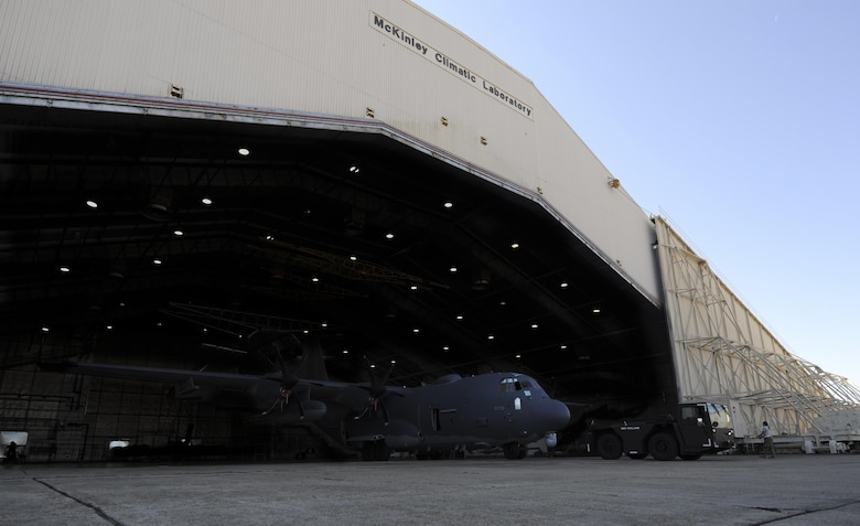 Air Commandos from the 1st Special Operations Aircraft Maintenance Squadron tow an AC-130J Ghostrider gunship out of the McKinley Climatic Laboratory at Eglin Air Force Base, March 22, 2017. The gunship underwent it's first cold soak, a test done to examine the aircraft's ability to function in temperature extremes. (Air Force photo by Airman 1s Class Dennis Spain)