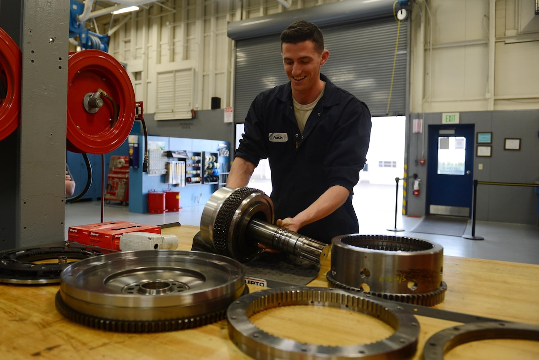 Airman 1st Class Justyn Zangwill, 627th Logistic Readiness Squadron fire truck and refuel maintenance journeyman, prepares to install a wet clutch assembly, March 21, 2017 at Joint Base Lewis-McChord, Wash. The wet clutch assembly was removed out of a fire truck and is being repaired, saving the Air Force an estimated $68,000. (U.S. Air Force photo/Senior Airman Divine Cox)