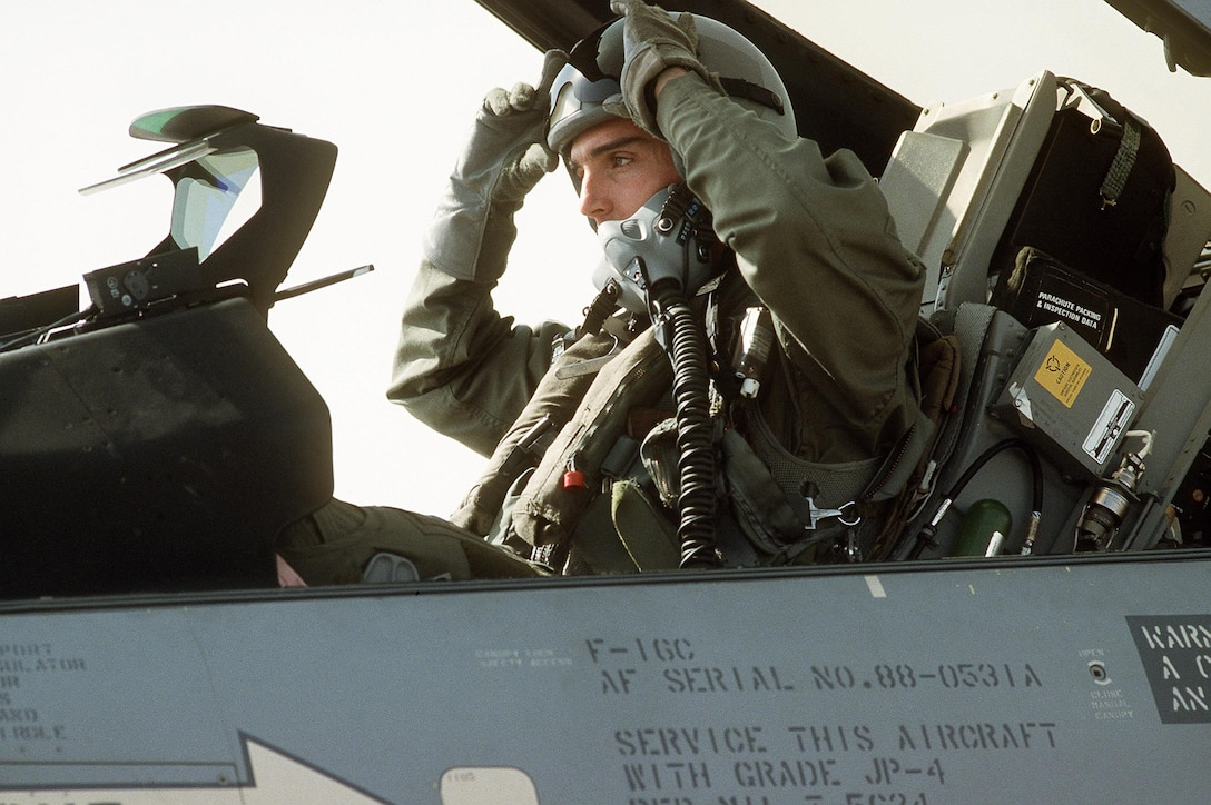 Capt. Marc Stalnaker, a pilot from the 421st Tactical Fighter Squadron, sits in the cockpit of his F-16C Fighting Falcon aircraft as it undergoes a preflight check during Operation Desert Storm. (U.S. Air Force photo)