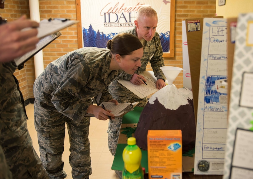 Judges, assigned to various sections across Mountain Home Air Force Base, Idaho critique a science fair volcano at Stephensen Elementary School,March 23, 2017. These volunteers judged the kindergarten through fourth grade students' projects in more than 10 areas to include hypothesis, application of the project and the students conclusion of their findings. (U.S. Air Force photo by Senior Airman Connor J. Marth/Released)
