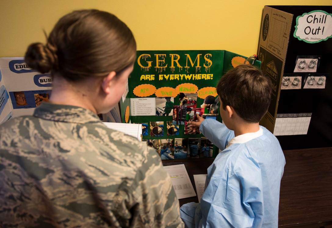 A student from Stephensen Elementary explains his science fair project to a judge at Mountain Home Air Force Base, Idaho, March 23, 2017. This year marks Stephensen Elementary's sixth annual science fair aimed at exposing children to science earlier. (U.S. Air Force photo by Senior Airman Connor J. Marth/Released)