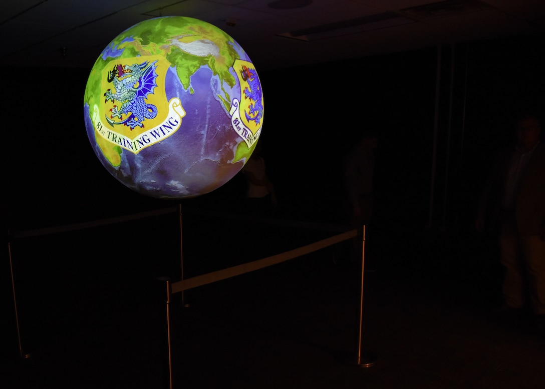 A Science on a Sphere hangs inside a 335th Training Squadron weather training room during a ribbon cutting ceremony at the Weather Training Complex March 23, 2017, on Keesler Air Force Base, Miss. This latest training aid displays planetary data onto a suspended carbon-fiber sphere helping instructors enhance student's understanding of the atmosphere. (U.S. Air Force photo by Kemberly Groue)