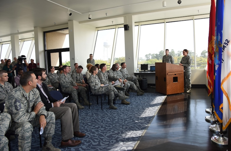 Lt. Col. Elizabeth Aptekar, 335th Training Squadron commander, delivers remarks during the unveiling of a Science on a Sphere at the Weather Training Complex March 23, 2017, on Keesler Air Force Base, Miss. This latest training aid displays planetary data onto a suspended carbon-fiber sphere helping instructors enhance student's understanding of the atmosphere. (U.S. Air Force photo by Kemberly Groue)