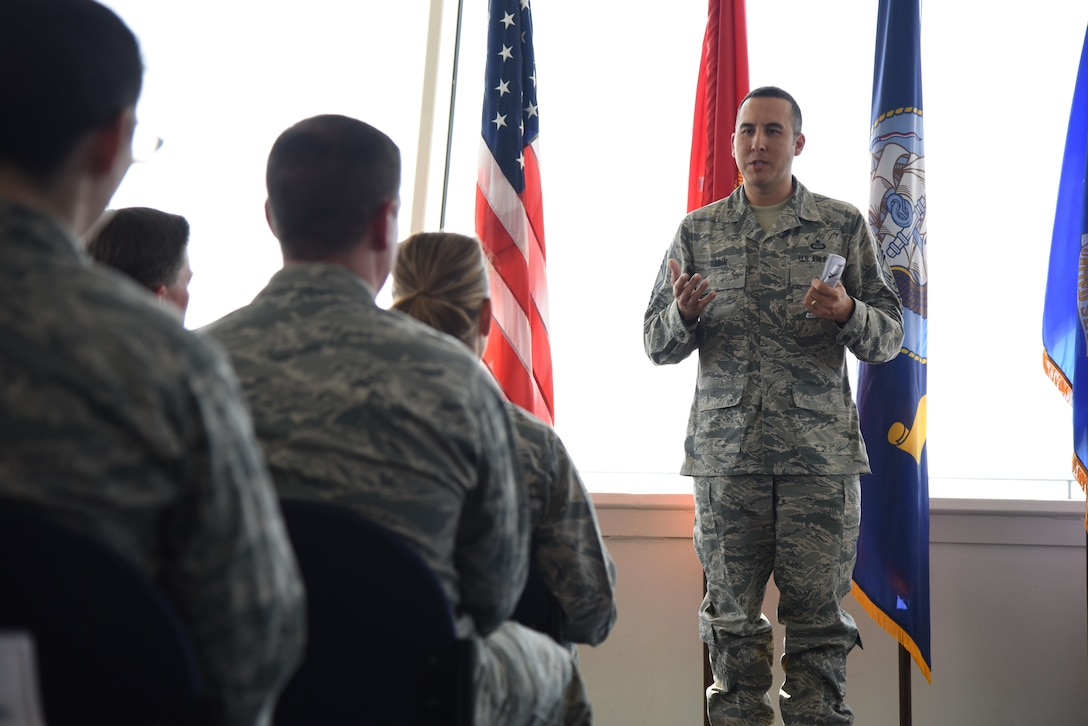 Chief Master Sgt. Randy Sabin, Air Education and Training Command weather functional manager, delivers remarks during the unveiling of a Science on a Sphere at the Weather Training Complex March 23, 2017, on Keesler Air Force Base, Miss. This latest training aid displays planetary data onto a suspended carbon-fiber sphere helping instructors enhance student's understanding of the atmosphere. (U.S. Air Force photo by Kemberly Groue)