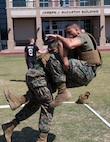 NEW ORLEANS - Cpl. Edward Morton, an administration clerk with Headquarters Battalion, Marine Forces Reserve, takes down Sgt. William Culp, the 4th Marine Aircraft Wing accounting chief, during the MARFORRES King of the Ring Competition at Marine Corps Support Facility New Orleans, March 22, 2017. The competition featured three separate events to include grappling, knife fighting, and combative baton, all hosted by the MARFORRES Martial Arts Team. The winners of the three competitions will earn a large trophy and the title as champion until next year's competition.  (U.S. Marine Corps photo by Cpl. Devan Alonzo Barnett/Released)