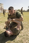 NEW ORLEANS - Cpl. Anthony Navarro (top) an administration clerk with Headquarters Battalion, Marine Forces Reserve, attempts a submission against Pfc. Niles Lee, a mass communications Marine with MARFORRES, during the MARFORRES King of the Ring Competition at Marine Corps Support Facility New Orleans, March 22, 2017. The competition featured three separate events to include grappling, knife fighting, and combative baton, all hosted by the MARFORRES Martial Arts Team. The winners of the three competitions will earn a large trophy and the title as champion until next year's competition.  (U.S. Marine Corps photo by Cpl. Devan Alonzo Barnett/Released)