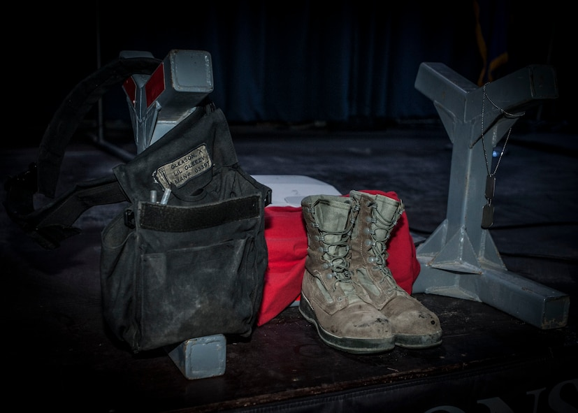 A munitions Y stand containing the weapons pouch, boots, and dog tags of Staff Sgt. Alexandria Morrow, 332nd Expeditionary Maintenance Squadron weapons load crew member, is displayed during a fallen warrior memorial ceremony Mar. 23, 2017, in Southwest Asia. Morrow died from injuries sustained while performing work duties in support of Operation Inherent Resolve. (U.S. Air Force photo by Staff Sgt. Eboni Reams)