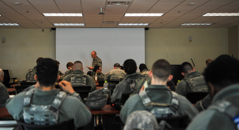 U.S. Air Force 8th Security Forces Squadron Airmen receive a mission briefing before a field training exercise at Kunsan Air Base, Republic of Korea, March 17, 2017. During briefings, security forces members receive information on hazards, safety and mission objectives. (U.S. Air Force photo by Senior Airman Colville McFee/Released)