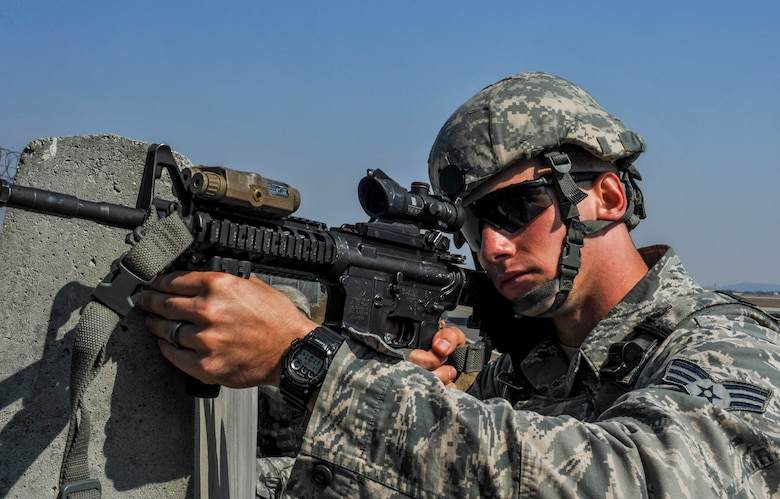 U.S. Air Force Senior Airman Brandon Weese, 8th Security Forces Squadron team leader, defends the base behind the cover of a concrete barrier with his M-4 assault rifle during a field training exercise at Kunsan Air Base, Republic of Korea, March 17, 2017. Opposing forces attack the security forces members to test their teamwork and communication skills under stressful situations. U.S. Airmen work side by side to integrate air and ground operations more effectively in order to deter aggression in the region. (U.S. Air Force photo by Senior Airman Colville McFee/Released)