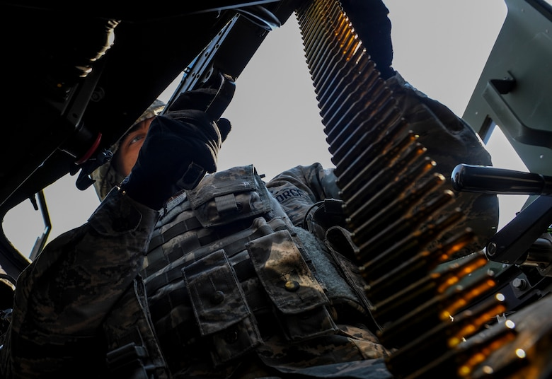 U.S. Air Force Airman 1st Class Jeremy Parnell, 8th Security Forces Squadron member, fires his M- 249mm Squad Automatic Weapon from the cover of his turret during a field training exercise at Kunsan Air Base, Republic of Korea, March 17, 2017. Opposing forces attack the security forces members to test their team work and communication skills under stressful situations. (U.S. Air Force photo by Senior Airman Colville McFee/Released)
