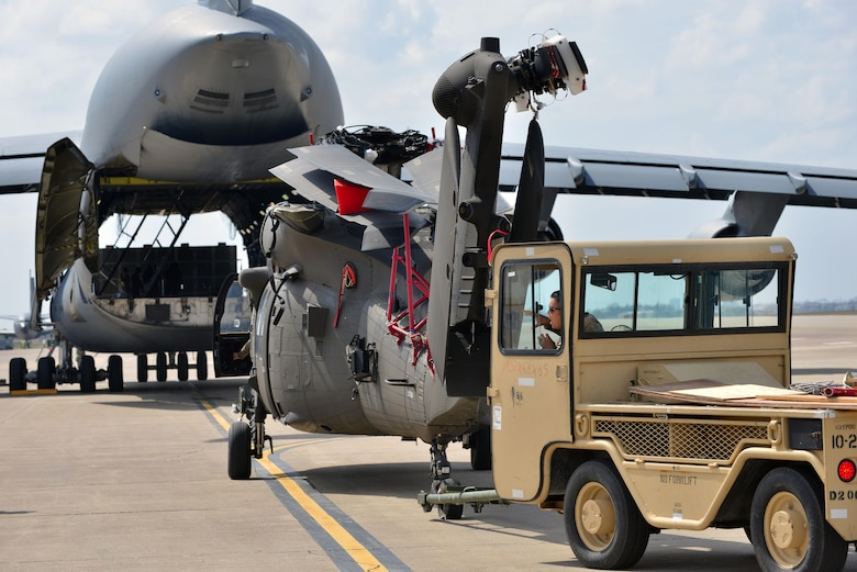 A U.S. Soldier with the 3rd Battalion, 501st Regiment, Combat Aviation Brigade, 1st Armored Division taxis a U.S. Army UH-60 Black Hawk toward a U.S. Air Force C-5M Super Galaxy for transport March 14, 2017, at Incirlik Air Base, Turkey. The soldiers were deployed to Europe in support of Operation Atlantic Resolve.  (U.S. Air Force photo by Senior Airman John Nieves Camacho)
