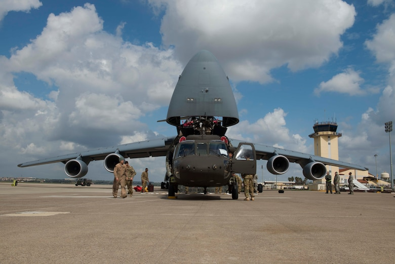 U.S. Airmen with the 22nd Airlift Squadron and U.S. Soldiers with the 3rd Battalion, 501st Regiment, Combat Aviation Brigade, 1st Armored Division prepare to load a U.S. Army UH-60 Black Hawk onto a U.S. Air Force C-5M Super Galaxy March 14, 2017, at Incirlik Air Base, Turkey. The unit was deployed to Incirlik in support of Operation Atlantic Resolve. (U.S. Air Force photo by Airman 1st Class Devin M. Rumbaugh)