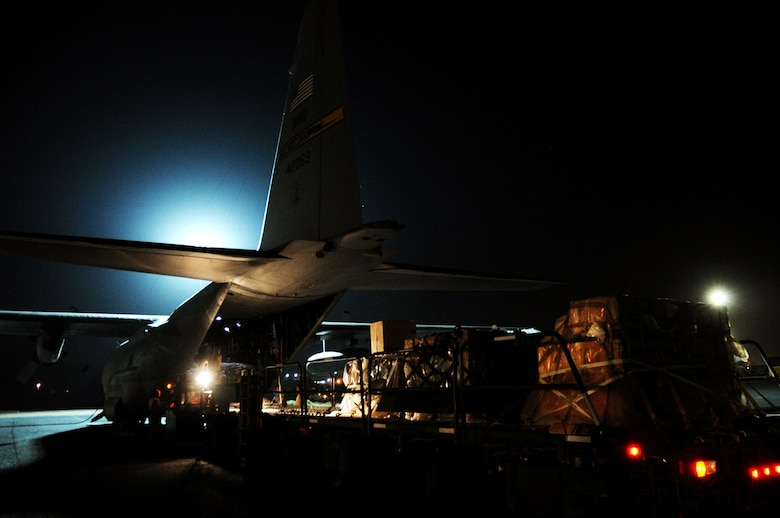 A C-130H Hercules is unloaded on the flightline by Airmen of the 386th Air Expeditionary Wing Mar. 3, 2017 at an undisclosed location in Southwest Asia. This aircraft is used to deliver personnel and cargo downrange in support of Operation Inherent Resolve.  (U.S. Air Force photo/Tech. Sgt. Kenneth McCann)