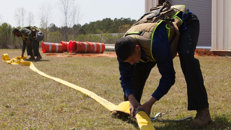 Lance Cpl. Milton Torres, a Marine with Chemical Biological Incident Response Force, prepares a hose for a decontamination drill at Guardian Centers in Perry, Ga., March 20, 2017, during Exercise Scarlet Response 2017.  The exercise, which goes from March 20 – 25, is the largest annual event for CBIRF, and it tests the unit's capabilities to react and respond to threats and disasters such as nuclear detonations.