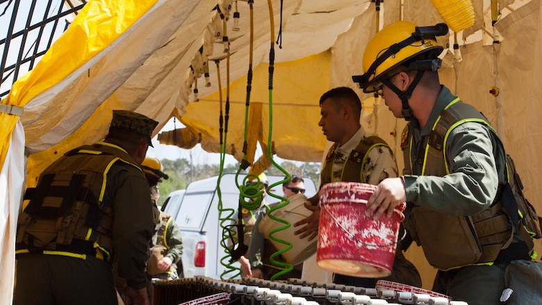 Marines with Chemical Biological Incident Response Force prepare a decontamination tent during a drill at Guardian Centers in Perry, Ga., March 20, 2017, during Exercise Scarlet Response 2017. The exercise, which goes from March 20 – 25, is the largest annual event for CBIRF, and it tests the unit's capabilities to react and respond to threats and disasters such as nuclear detonations.
