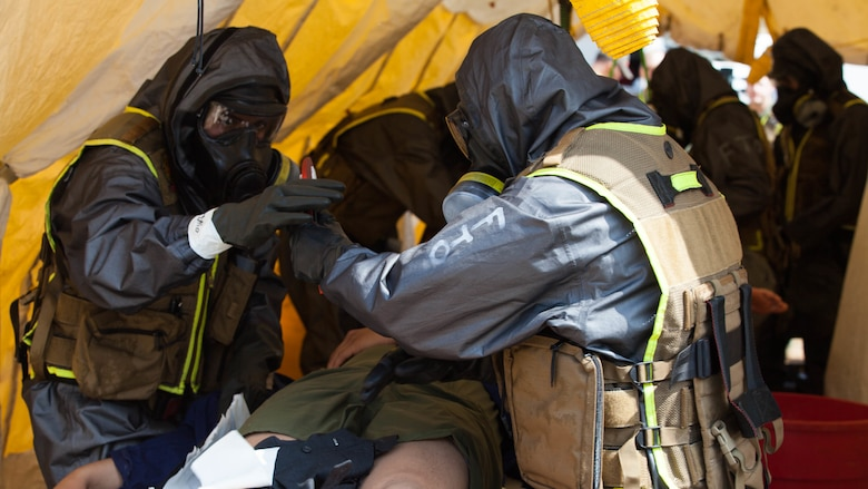 Marines with Chemical Biological Incident Response Force strip and decontaminate casualties during a drill at Guardian Centers in Perry, Ga., March 20, 2017, during Exercise Scarlet Response 2017. The exercise, which goes from March 20 – 25, is the largest annual event for CBIRF, and it tests the unit's capabilities to react and respond to threats and disasters such as nuclear detonations.