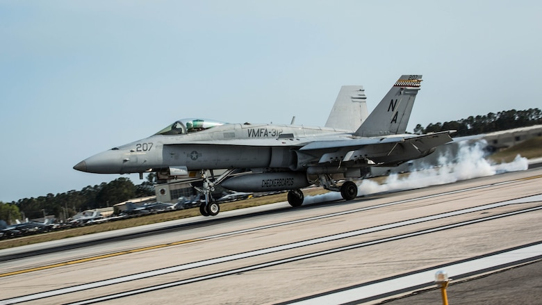 An F/A-18C Hornet aircraft conducts a simulated aircraft carrier landing aboard Marine Corps Air Station Beaufort, March 22, 2017. The runway is equipped with a painted outline simulating the carrier for the pilots. The Marine and aircraft are with Marine Fighter Attack Squadron 312, Marine Aircraft Group 31.