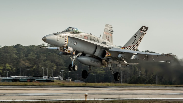 An F/A-18C Hornet aircraft takes off during a field carrier landing practice aboard Marine Corps Air Station Beaufort, March 22, 2017. Marine Fighter Attack Squadron 312 conducts the training before embarkation aboard carriers. This FCLP was conducted in preparation for an upcoming exercise aboard the USS Theodore Roosevelt, a naval aircraft carrier, scheduled for April. The pilot and the aircraft are with VMFA-312, Marine Aircraft Group 31.
