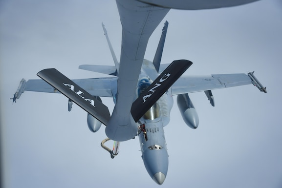 An F-18 fighter jet gets refueled as Brigadier General Paul Jacobs, Assistant Adjutant General - Air, Joint Force Headquarters, Alabama Air National Guard observes during a familiarization flight with the 117th Air Refueling Wing March 12, 2017. (Air National Guard photo by Senior Airman Wes Jones)