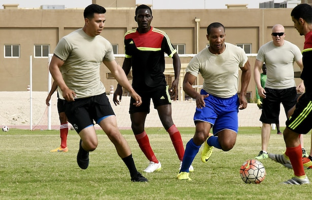 U.S. Air Force Airmen with the 379th Expeditionary Security Forces Squadron play soccer with Qatar Emiri Air Force Security Forces members at Al Udeid Air Base, Qatar, March 23, 2017. The Airmen participated in a friendly game of soccer held to give members a chance to interact with their host nation partners. (U.S. Air Force photo by Senior Airman Cynthia A. Innocenti)