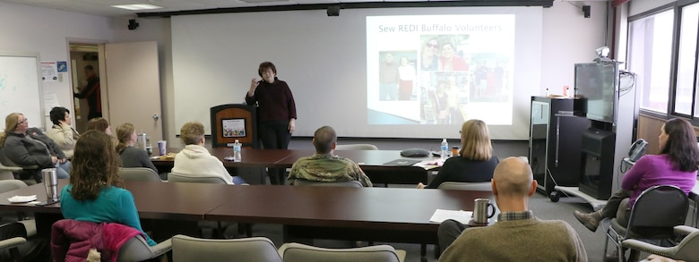 Dr. Patricia Hutton, founder of the Sew Refugee Economic Development Initiative (REDI) address USACE Buffalo District staff during Women's History Month.