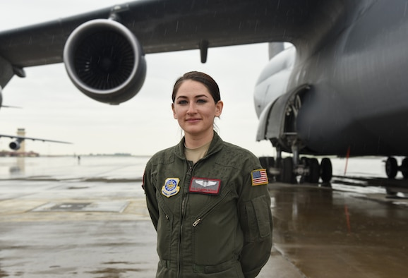 Senior Airman Cassandra Hickman, 22nd Airlift Squadron C-5 Galaxy loadmaster, stands in front of a C-5 at Travis Air Force Base, Calif., March 20, 2017. Hickman was the first female in her family to join the military. (U.S. Air Force photo by Senior Airman Sam Salopek)
