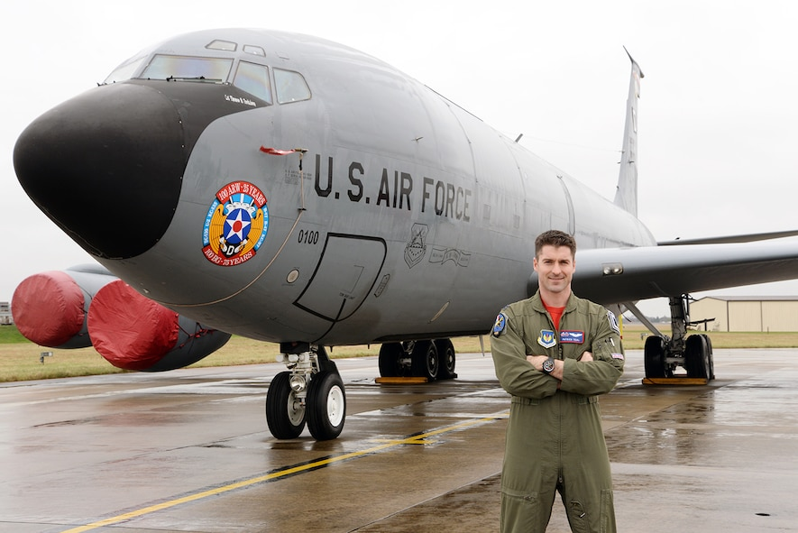 U.S. Air Force Capt. Patrick Teal, 351st Air Refueling Squadron pilot and aircraft commander poses for a photo in front of a 100th Air Refueling Wing KC-135 Stratotanker, March 3, 2017, on RAF Mildenhall, England. This is the wing's lead jet and is the only RAF Mildenhall aircraft to display the 100th ARW's 25th Anniversary logo as nose art. Teal's father, a former navigator in the U.S. Air Force, was also stationed at RAF Mildenhall and arrived Feb. 1, 1993, exactly one year after the activation of the 100th ARW. (U.S. Air Force photo by Karen Abeyasekere)