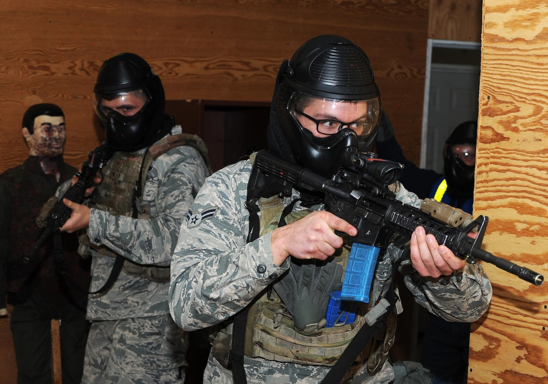 (Left to right) Senior Airman Dustin Fowler and Airman 1st Class Bryan Butler, 5th Security Forces Squadron defenders participate in close quarter battle training at Minot Air Force Base, N.D., March 16, 2017. The CQB training was part of the Global Strike Challenge tryouts for the 5th SFS. (U.S. Air Force photo/Senior Airman Kristoffer Kaubisch)