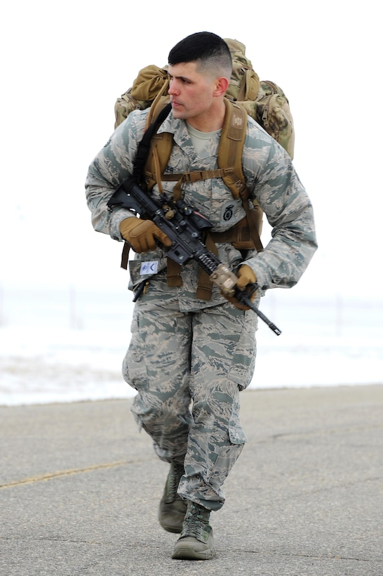 Senior Airman Dustin Fowler, 5th Security Forces Squadron, runs during a ruck at Minot Air Force Base, N.D., March 16, 2017. The ruck was one of the many requirements for the Global Strike Challenge tryouts for the 5 SFS. (U.S. Air Force photo/Senior Airman Kristoffer Kaubisch)