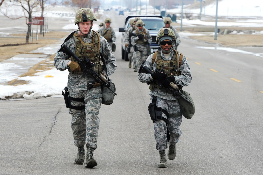 Defenders from the 5th Security Forces Squadron run during a buddy run at Minot Air Force Base, N.D., March 16, 2017. The buddy run was part of tryouts for the 2017 Global Strike Challenge. (U.S. Air Force photo/Senior Airman Kristoffer Kaubisch)