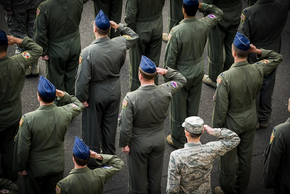 Members of the 374th Operations Group salute during a retreat ceremony March 17, 2017, at Yokota Air Base, Japan. The retreat ceremony serves as a way to pay respect to the flag and signals the end of the official duty day with the playing of the national anthem while lowering and folding the flag. (U.S. Air Force photo/Airman 1st Class Donald Hudson)
