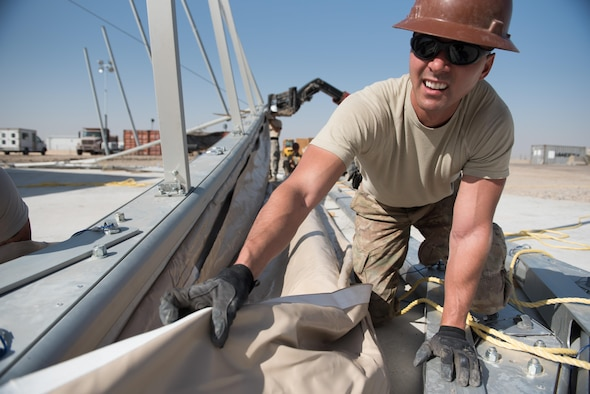 Staff Sgt. Dustin Brooks, a 577th Expeditionary Prime Beef Squadron structures craftsman, installs canvas onto a 4k dome at the 407th Air Expeditionary Group, March 21, 2017. Brooks was part of a team which deployed to assist the 407th Expeditionary Civil Engineer Squadron with erecting large structures on base. (U.S. Air Force photo/Master Sgt. Benjamin Wilson)