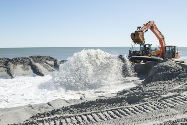 The Charleston District was able to dredge material from the channel and place it on Murrells Inlet because the material was made up of 90% sand.